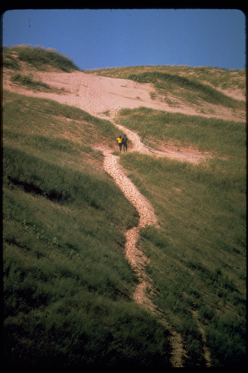 two people climbing up a path at Sleeping Bear Dunes
